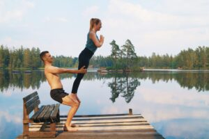 An acroyoga counterbalance where two people lean away from each other