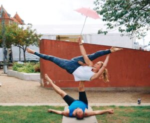 An acroyoga pose with passive flexibility splits