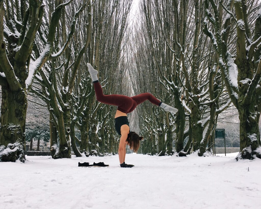 A fun handstand in the snow with little thought to alignment