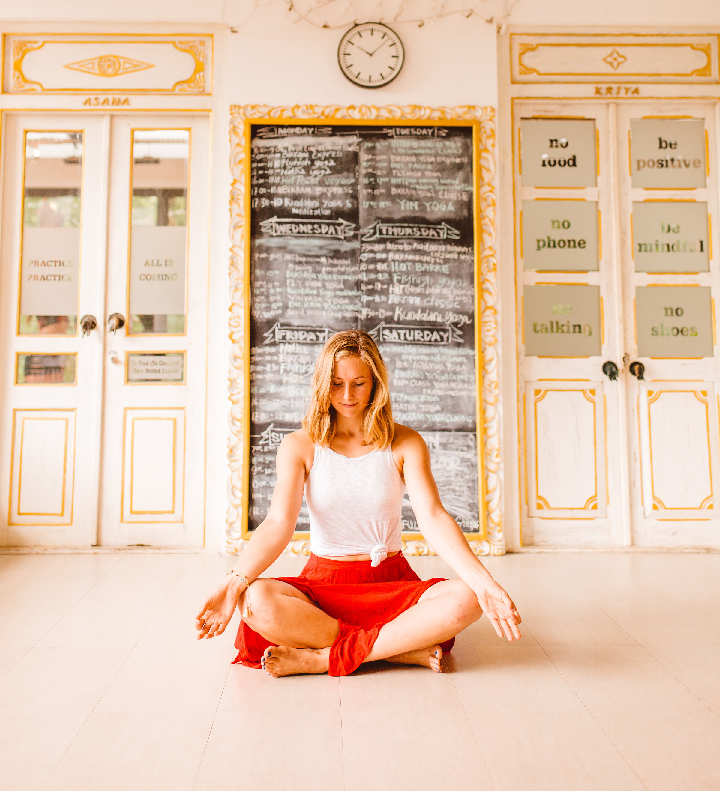 Camilla sitting in a meditation pose at the graduation day of her yoga teacher training in Ubud, Bali