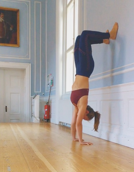 Back to wall handstand exercise