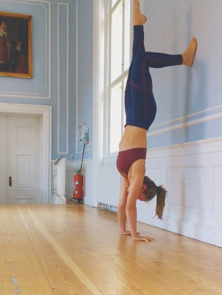 Back to wall handstand exercise with one leg up