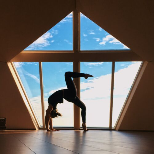 Sustainable yoga and movement practice of wheel pose.