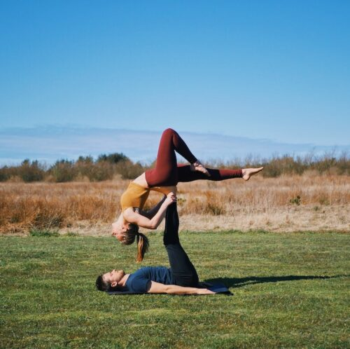 Backbird pose from acroyoga with a stag leg, which is one of the beginner friendly acroyoga poses