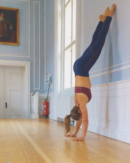 Belly to wall handstand exercise walking hands in