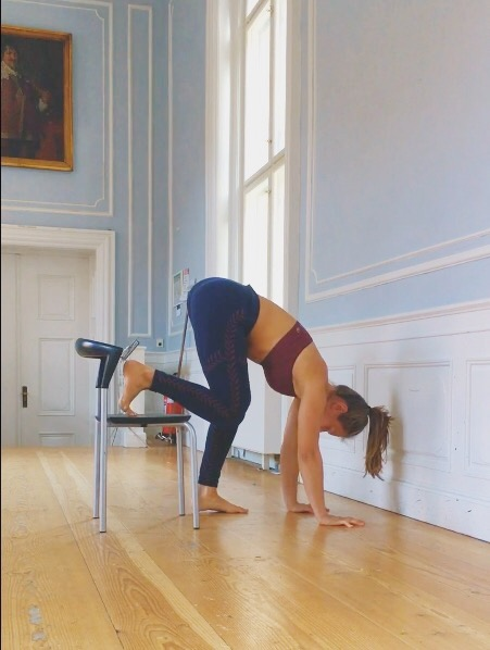 Chair assisted wall handstand exercise