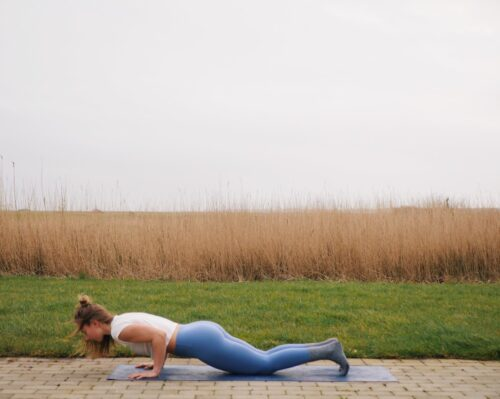 Camilla showing a chaturanga variation on knees from the sun salutations in yoga