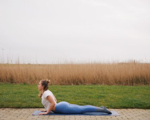 Camilla showing Cobra Pose (Bhujangasana) from the sun salutations in yoga
