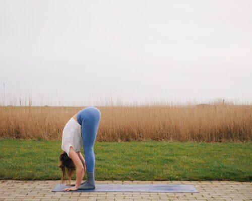 Camilla showing Standing Forward Fold (Uttanasana) from the sun salutations in yoga