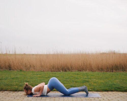 Camilla showing Knees-chest-chin (Ashtanga Namaskara) from the sun salutations in yoga
