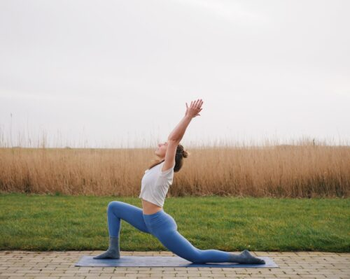 Camilla showing Crescent Low Lunge (Anjaneyasana) from the sun salutations in yoga