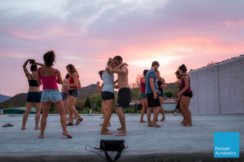 Rooftop dancing at partner acrobatics teacher training to become an acroyoga coach