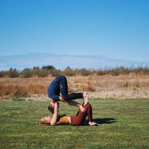 Entry into shoulderstand on knees pose from acroyoga, which is one of the intermediate friendly acroyoga poses
