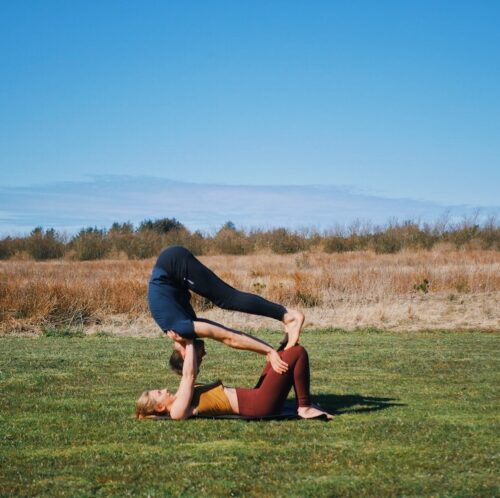 Entry into shoulderstand on knees pose from acro yoga, which is one of the intermediate friendly acro yoga postures.