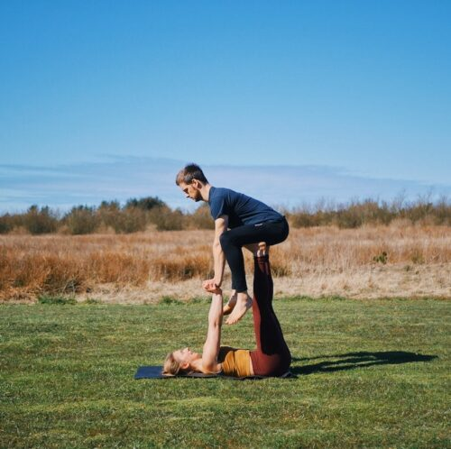 Entry into throne pose from acroyoga, which is one of the beginner friendly acroyoga poses