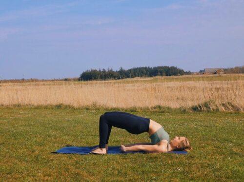 A yoga hip + spine stretch to prepare for wheel pose