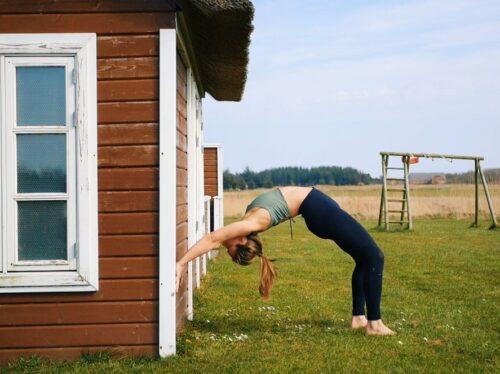 Modifying yoga wheel by the wall