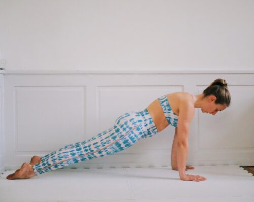 Plank on tops of feet to prep for handstand and assess if you're ready for handstands