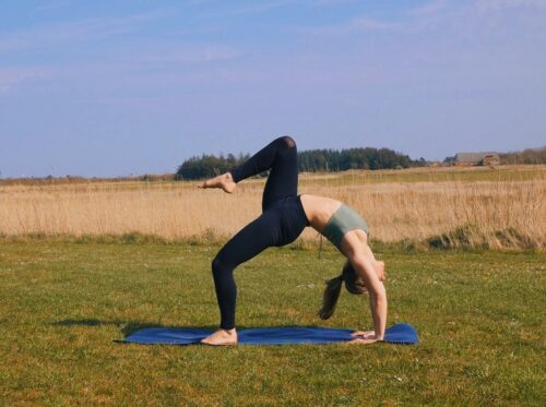 Wheel pose variation from yoga with the knee lifted