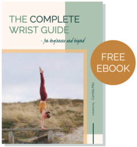 Free wrist ebook to avoid wrist pain in yoga and build strong and flexible wrists for plank, downward dog, arm balances, and handstand without any aches and pains.